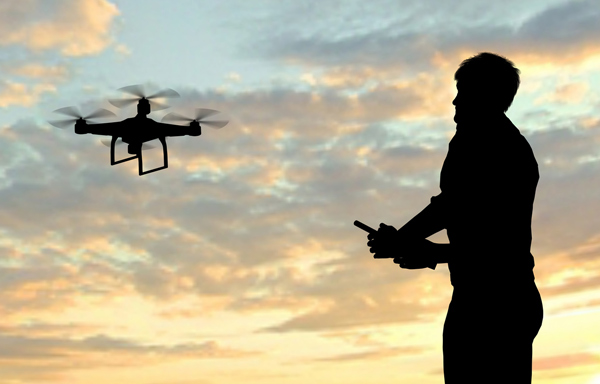 (Man playing drones, photography.com)